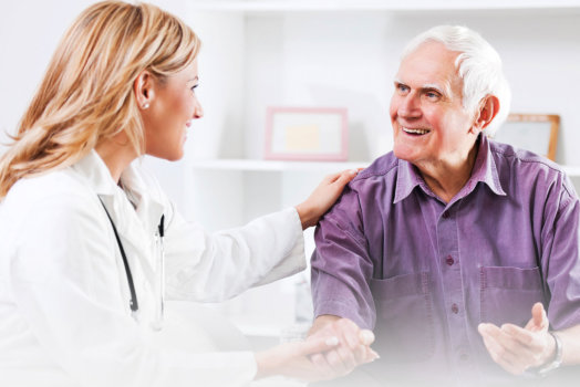 Doctor having conversation with elderly man