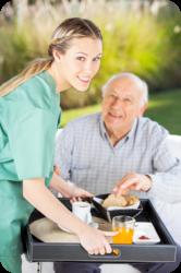 caregiver preparing breakfast to the senior